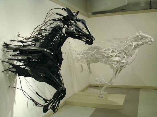 Mechanical Horses galloping out of a wall